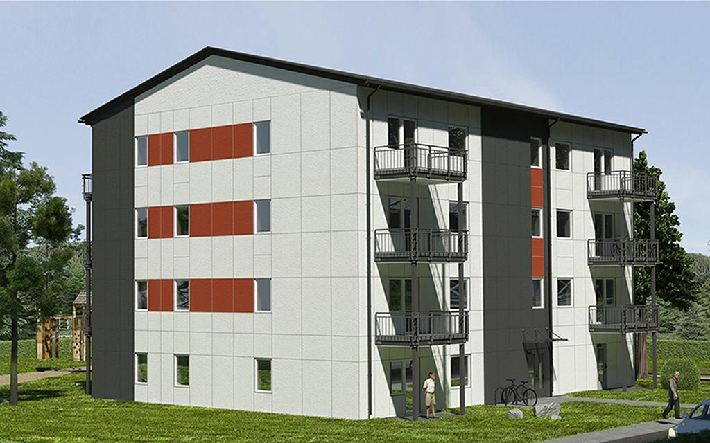 Vitt modulhus med röda detaljer fyra våningar